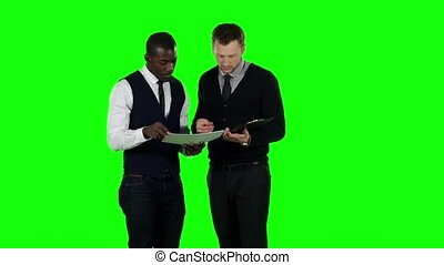 Businessmen consider the documents. Green screen