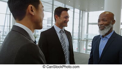 Businessmen discussing in the office 4k - Three businessmen...