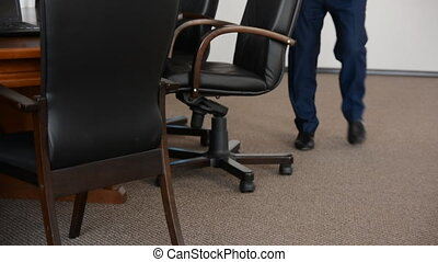 Businessmen go to the conference room for a meeting. Leather...