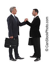 Businessmen gripping hands