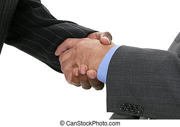 Businessmen Hands - Close-up of businessmen in suits shaking...