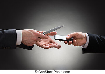 Businessmen Hands With Knife And Mobile Phone
