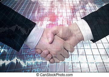 Businessmen handshake on building background