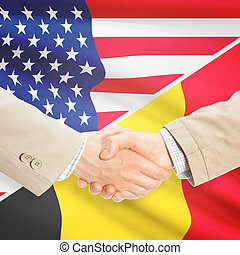 Businessmen shaking hands - United States and Belgium