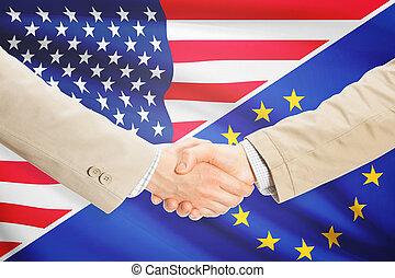 Businessmen handshake - United States and European Union