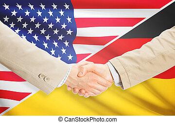 Businessmen handshake - United States and Germany -...