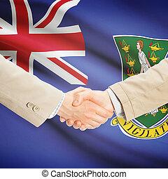 Businessmen handshake with flag on background - British Virgin Islands
