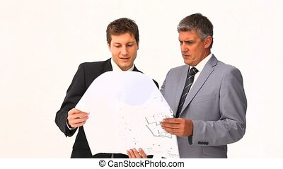 Businessmen holding a building plan
