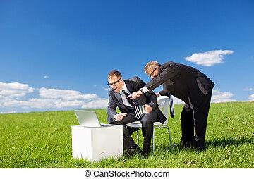 Businessmen in green meadow - Portrait of two businessmen...