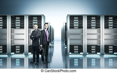 Businessmen in server room