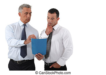 businessmen looking at a report
