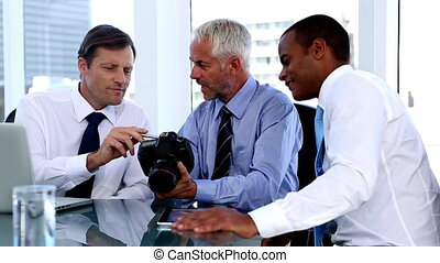 Businessmen looking at camera