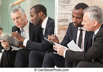 Businessmen looking at paper