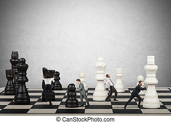Strategy and tactics in business - Businessmen move the ...