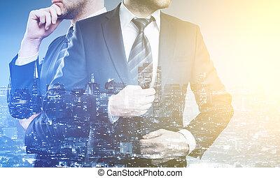 Businessmen on city background