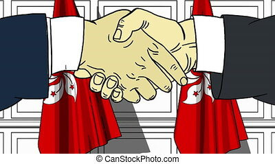 Businessmen or politicians shake hands against flags of Hong...