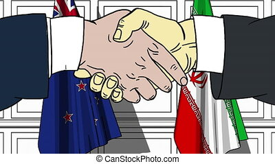 Businessmen or politicians shake hands against flags of New...
