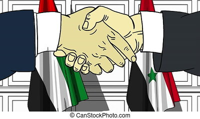 Businessmen or politicians shake hands against flags of UAE...