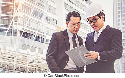 Businessmen planning construction project