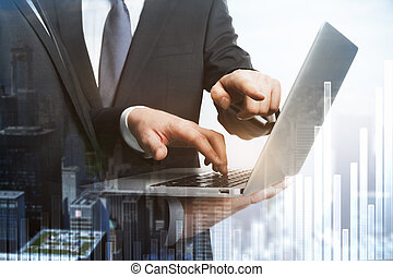 Businessmen pointing at laptop
