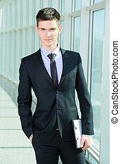 Businessmen - Portrait of a smiling handsome businessman in...