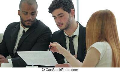 Businessmen reading documents - Smiling businessman in a...