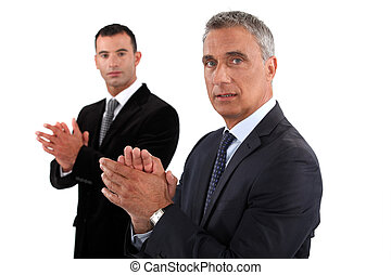 Businessmen rubbing their hands