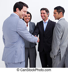 Businessmen shaking hands against