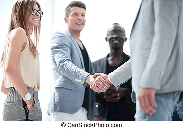 Businessmen shaking hands. Two confident businessmen shaking hands and smiling