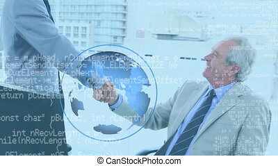 Businessmen shaking hands with rotating globe in foreground