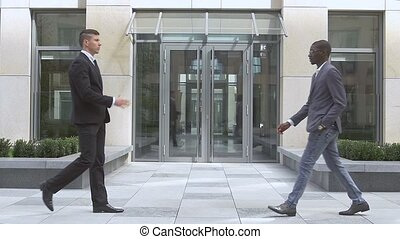 businessmen shaking hands,success multiracial Businesspeople, slow motion