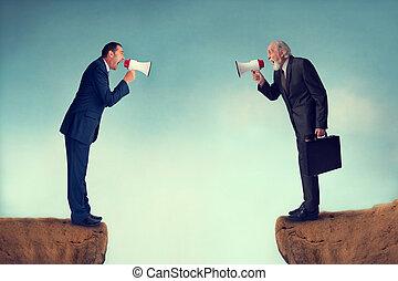 business conflict - businessmen shouting through megaphones...