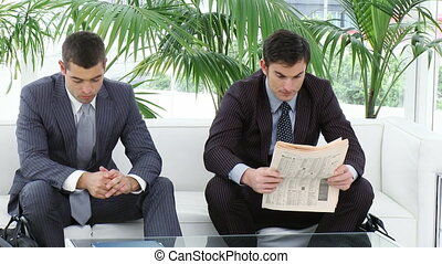 Businessmen sitting on sofa