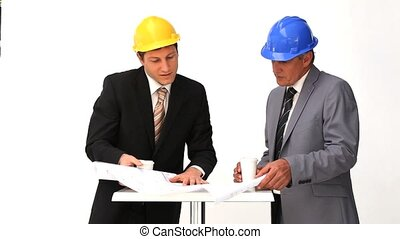Businessmen speaking about a building project