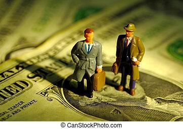 Businessmen - Miniature Businessmen Standing on Money.