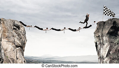 Businessmen support bridge to get to the flag. Achievement business goal concept