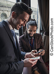 Businessmen Swapping Contact Details - Side view of two...