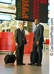 businessmen travelling together