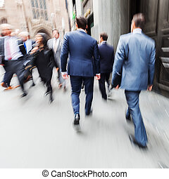 businessmen walking in city