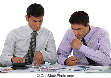 Businessmen with a calculator