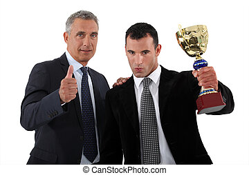 Businessmen with a trophy