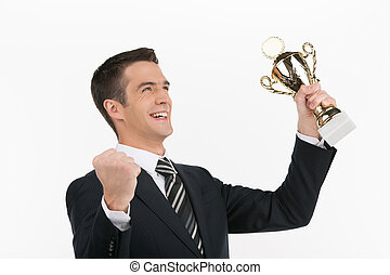 Businessmen with business trophy. Cheerful young businessman...