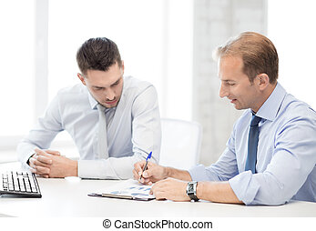 businessmen with notebook on meeting - businessmen with...