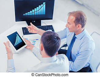businessmen with tablet pc and computer at office