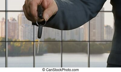 Businessmen's hands pass car key.
