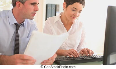 Businesspartners in an office with papers