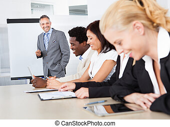 Businesspeople At Presentation