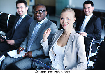 Businesspeople at seminar - Image of business people sitting...