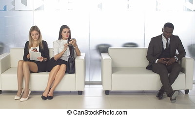 Businesspeople chatting and waiting for interview