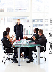 Businesspeople clapping in a meeting